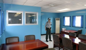 Republic of Korea (i.e. South Korea) soldier inside the MAC conference room.
