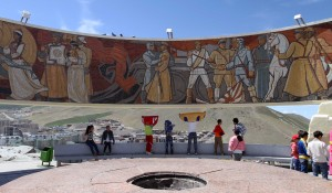 Soviet propaganda and children playing in the wind on the Zaisan monument.