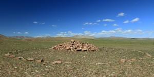 Circular rock mound burial.