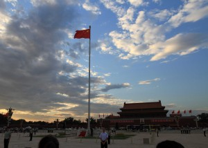 Crowds gathering to watch the flag of China being taken down for the day.