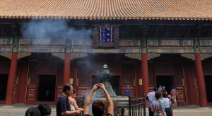 Worshipers praying with incense at the Yonghegong Lama Temple.