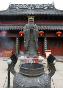Statue of Confucius in front of the main hall inside the temple complex.