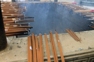 Hundreds of incense sticks burning around a pit inside Jing'an Temple.