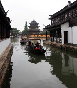 Canal in the ancient town of Zhujiajiao with temple in the background.