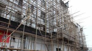 Bamboo scaffolding covering a building in the modern town of Zhujiajiao.