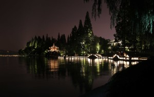The path around West Lake lit up at night, giving it a magical look.