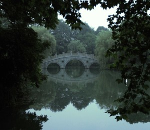 Bridge over a pond in the late evening.