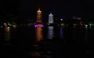 The Sun and Moon Pagodas at night, lit to reflect their namesakes.