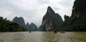 The steep limestone mountains towering above the river.