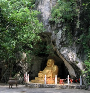 Giant statue of Buddha sitting in a cave seen during my walk in Guilin.