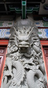 Dragon sculpture on one of the outside columns supporting the main hall in Po Lin Monastery.