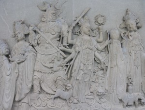 Relief on the outside of the main hall in Po Lin Monastery.