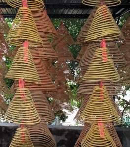 Conical, spiral incense sticks burning in A-Ma Temple.