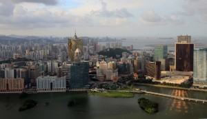 The copper reflection of the Wynn cast on Nam Van Lake, seen from Macau Tower.