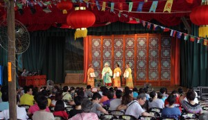 Chinese opera being conducted in the large theater in Tai O.