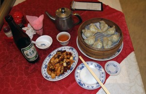 My dinner of tea, beer, shrimp filled dumplings, and kung-pao chicken.