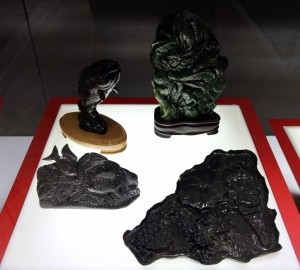 Black jade sculptures on display inside the museum.