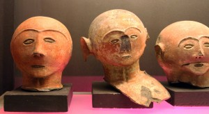 Earthenware heads that once adorned the tops of funeral urns.