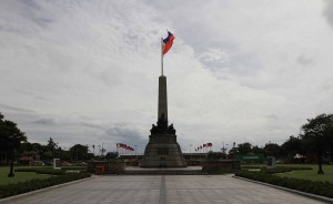Monument to Dr. Jose Rizal with Philippines national flag in background.