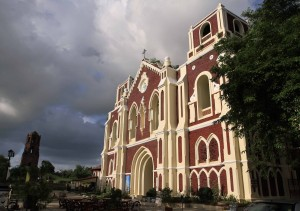 St. Augustine Parish Church with the Bantay Tower in the background.