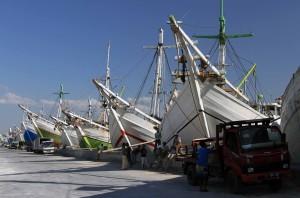 View of pinisi boats docked in Sunda Kelapa Port.