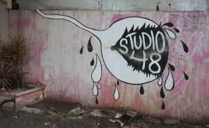 "Strange sign for ""Studio 48"" featuring a sobbing spermatozoa - I'm too scared to inquire what type of club this is."