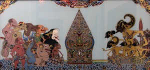 Painting depicting a two-dimensional Indonesian puppet show.