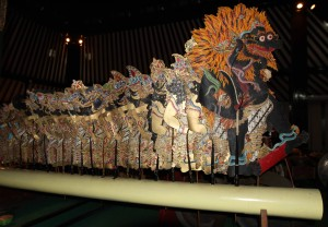 Two-dimensional puppets made from buffalo leather lined up along the stage.