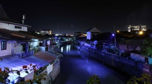 River in Yogyakarta lit up at night.