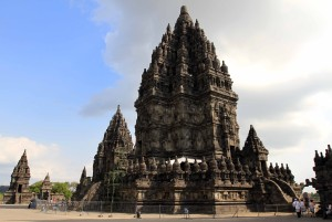 The main building at the Prambanan temple complex seen with a fence surrounding it.