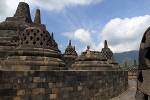 The main stupa at the top of Borobudur seen on the left.