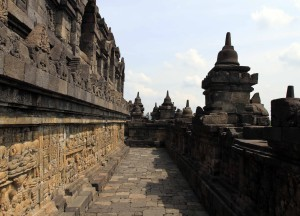 One of the lower tiers at Borobudur lined with reliefs and sculptures.