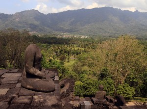 Headless Buddha statue on the edge of Borobudur temple.