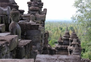 Buddha statues lining the top of one of Borobudur's lower tiers.
