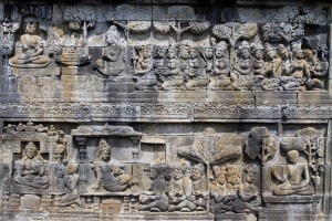 Relief depicting many people.