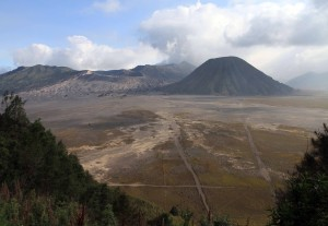 View of Mount Bromo and Mount Batok (the more complete and conical-looking volcano) in the giant caldera.