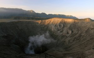 The volcanic opening of Mount Bromo seen at sunset.