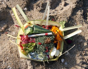 "A small offering (""canang sari"") found on the beach - Balinese offer these to their gods three times a day. After all, what god doesn't like to smoke cigarettes?"