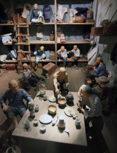 Diorama showing a typical lodge for Chinese immigrants during the late 19th-century.