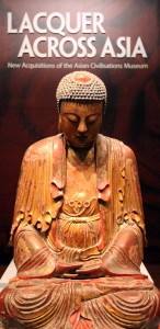 Red lacquered Buddha sculpture.