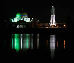 Melaka Straits Mosque seen from the beach at night.