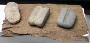 Stone tools with criss-cross pattern used to beat and soften tree bark to make cloth.