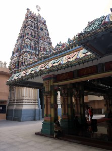 The edge of the Main Prayer Hall with gopuram in the background.