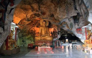 Forty-foot high Buddha statue in Perak Tong cave temple.