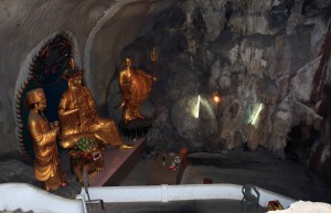 Another shrine inside the cave temple with Buddhist statues.