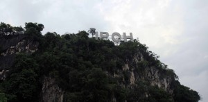 Sign for the city of Ipoh, perched on top of a limestone mountain.