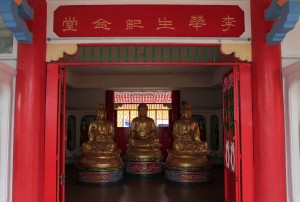 Three Buddha statues on the second floor of the hall.