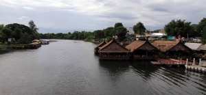 Floating restaurants located next to the bridge.