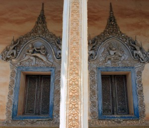 Reliefs of men fighting around the windows of the main temple in Wat Bo.