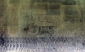 Bas-relief depiction of elephants and soldiers marching.